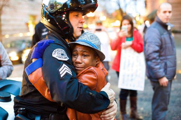 Officer Barnum and Devonte Hart Embrace At Ferguson Protest