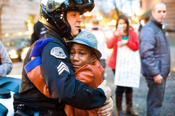 Officer Barnum and Devonte Hart Embrace At Ferguson Protest